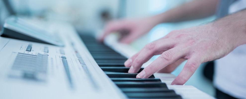 Musician playing an electric piano